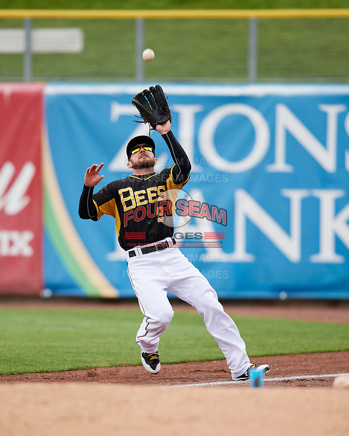 Shane Robinson (9) of the Salt Lake Bees on defense against the El Paso Chihuahuas in Pacific Coast League action at Smith's Ballpark on April 30, 2017 in Salt Lake City, Utah. El Paso defeated Salt Lake 12-3. This was Game 1 of a double-header. (Stephen Smith/Four Seam Images)