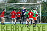 Abbeydorney keeper  Mikey Clifford clears his lines despite pressure from Alan O'Connor of Manor West FC in the Denny soccer league in Mounthawk Park on Sunday
