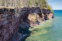 The pristine water of Lake Superior and the beautiful sandstone cliffs at the Presque Isle park on a sunny spring day. Marquette, MI