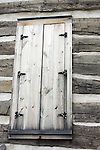 historical log cabin window building logcabin structure old past long ago 150 years historic deterioration aging fashioned glass wood recycle build by hand home house farm settlement settle memories united states west time plaster construction material stripes door security locked lock secure safe protected preservation preserve logs shutters 1849 Sparrow Cabin restoration restored