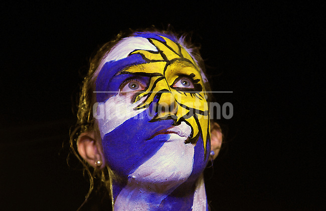 A Uruguay supporter reacts during the soccer World Cup match between Colombia and Uruguay<br />  on Copacabana beach, Rio de Janeiro, Brazil, June 28, 2014