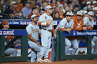 Texas Longhorns head coach David Pierce gives defensive signs to his team during the game against the LSU Tigers in game three of the 2020 Shriners Hospitals for Children College Classic at Minute Maid Park on February 28, 2020 in Houston, Texas. The Tigers defeated the Longhorns 4-3. (Brian Westerholt/Four Seam Images)