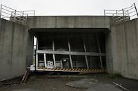 A landscape view of a damaged cement sea wall gate at Miyako Bay during reconstruction efforts following the 311 Tohoku Tsunami in Miyako, Japan  © LAN
