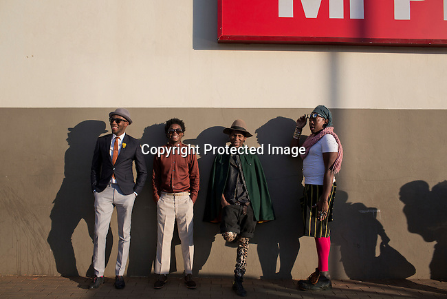 SOWETO, SOUTH AFRICA JULY 4: Lethabo Tsatsinyane, Teekay Makwale, Floyd Avenue and  Sibu Sithole young designers part of the group Smarteez at Jabulani shopping mall on July 4, 2014 in Jabulani section of Soweto, South Africa. Soweto today is a mix of old housing and newly constructed townhouses. A new hungry black middle-class is growing steadily. Many residents work in Johannesburg but the last years many shopping malls have been built, and people are starting to spend their money in Soweto. (Photo by: Per-Anders Pettersson)