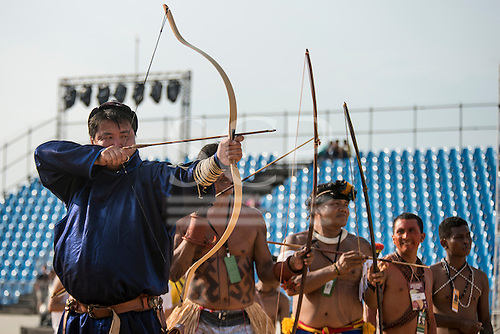 A Mongolian archer lines up with delegates from Brazil and  the Phillippines at the  International Indigenous Games, in the city of Palmas, Tocantins State, Brazil. Photo © Sue Cunningham, pictures@scphotographic.com 28th October 2015