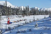 Joan Klejka and team run down the trail on the Denali Highway with the Alaska Range in the background during the start day of the 2015 Junior Iditarod on Sunday March 1, 2015<br /> <br /> <br /> <br /> (C) Jeff Schultz/SchultzPhoto.com - ALL RIGHTS RESERVED<br />  DUPLICATION  PROHIBITED  WITHOUT  PERMISSION
