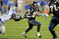 4 December 2010:  FIU running back Darriet Perry (28) evades Middle Tennessee linebacker Gorby Loreus (43) while carrying the ball in the first quarter as the Middle Tennessee State University Blue Raiders defeated the FIU Golden Panthers, 28-27, at FIU Stadium in Miami, Florida.