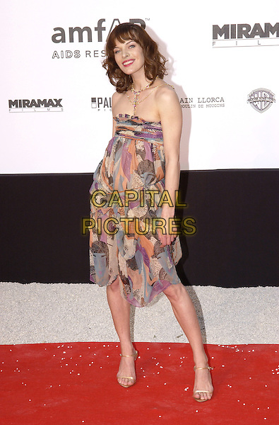 MILLA JOVOVICH.Arrives at the amfAR Cinema Against AIDS 2005, held during the 58th Cannes International Film Festival, Cannes, France, May 19th 2005..full length jovovitch strapless dress patterned print.Ref: FIN.www.capitalpictures.com.sales@capitalpictures.com.©Steve Finn/Capital Pictures.