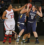RAPID CITY, S.D. -- DECEMBER 7, 2013 -- Polly Harrington #33 of the University of South Dakota reaches for a ball controlled by Megan Rohrer #33 of South Dakota Mines during their game Saturday at the Rushmore Plaza Civic Center Ice arena in Rapid City, S.D.  Anne Soenneker #11 of South Dakota Mines is also in on the action. (Photo by Dick Carlson/Inertia)