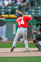 Guillermo Heredia (14) of the Tacoma Rainiers at bat against the Salt Lake Bees in Pacific Coast League action at Smith's Ballpark on July 22, 2016 in Salt Lake City, Utah. The Rainiers defeated the Bees 8-3. (Stephen Smith/Four Seam Images)