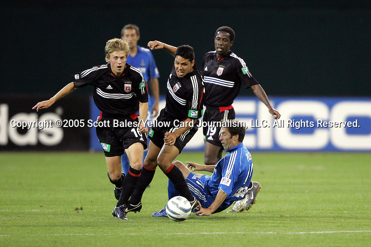 21 May 2005: Kansas City's Preki (on ground) loses the ball to DC United's Brian Carroll (left) and Cristian Gomez. DC United defeated the Kansas City Wizards 3-2 at RFK Stadium in Washington, DC in a regular season Major League Soccer game. .