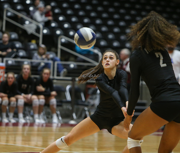 Rouse Raiders sophomore Grayson Schirpik (4) digs the ball during the Class 5A high school volleyball state final between Rouse High School and Prosper High School at Curtis Culwell Center in Garland, Texas, on November 18, 2017. Prosper won the match in five sets, (25-18, 21-25, 18-25, 25, 23, 16-14) to win the 5A state championship.