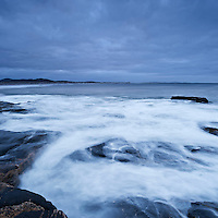 Waves crash over rocky coat, South Uist, Western Isles, Scotland
