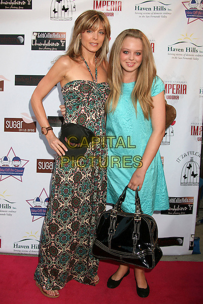 "MARLA MAPLES & TIFFANY TRUMP.""Hats Off For Cancer"" Benefit Party at Sugar Boutique, Hollywood, California, USA..May 9th, 2007.full length green pattern halterneck dress turquoise black purse bag oversized big baseball cap hat .CAP/ADM/BP.©Byron Purvis/AdMedia/Capital Pictures"