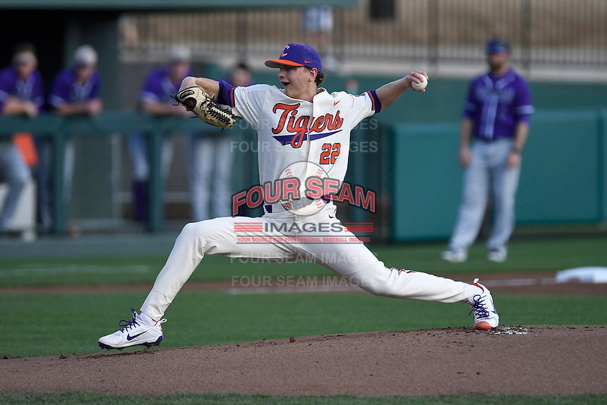 Starting pitcher Sam Weatherly (22) of the Clemson Tigers delivers a pitch in a game against the Furman Paladins on Tuesday, February 20, 2018, at Doug Kingsmore Stadium in Clemson, South Carolina. Clemson won, 12-4. (Tom Priddy/Four Seam Images)