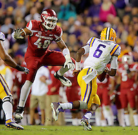 11/14/15<br /> Arkansas Democrat-Gazette/STEPHEN B. THORNTON<br /> Arkansas' Deatrich Wise Jr. leaps to pressure LSU's QB Brandon Harris into throwing an incomplete pass in the second quarter of their game Saturday in Baton Rouge, La.