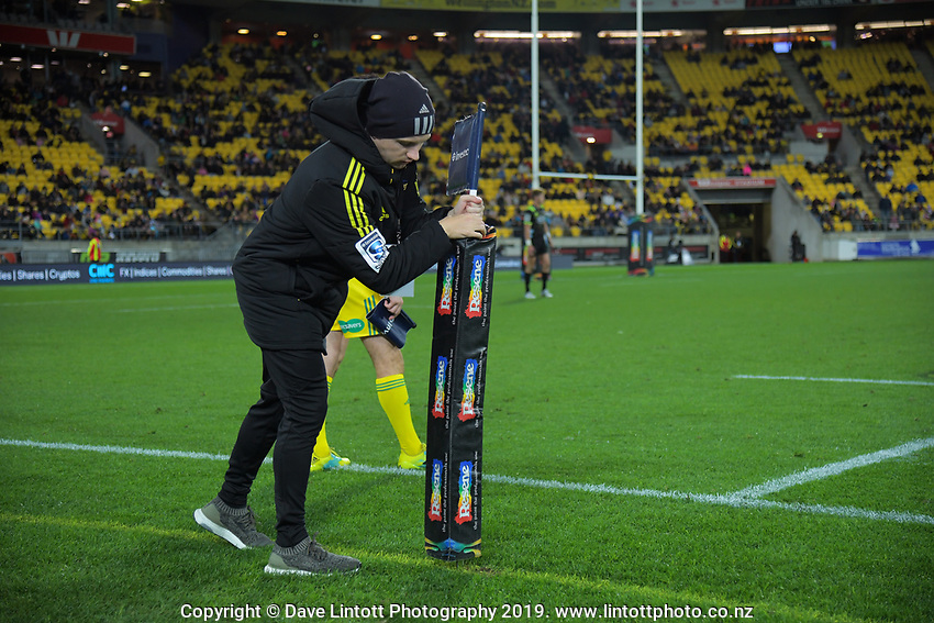 Match operations manager Johnny Schmitt replants a flag during the Super Rugby match between the Hurricanes and Rebels at Westpac Stadium in Wellington, New Zealand on Saturday, 4 May 2019. Photo: Dave Lintott / lintottphoto.co.nz