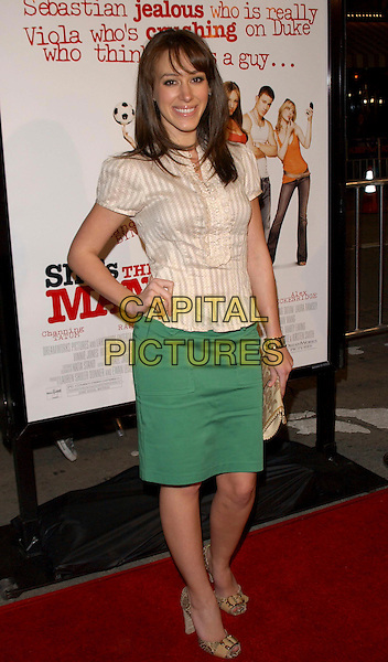 """HAYLIE DUFF.L.A. Premiere of """"She's The Man"""" held at The Mann Village Theatre in Westwood, California, USA. .March 8th, 2006.Ref: DVS.full length cream blouse green skirt hand on hip.www.capitalpictures.com.sales@capitalpictures.com.Supplied By Capital PIctures"""