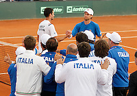 Italy's team  celebrate  after winning    Davis Cup quarter-final tennis match against Britainy and qualify for semifinal  in Naples April 6, 2014.