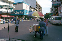 People chatting and shopping on Avenida Central pedestrian mall in Panama City, Panama