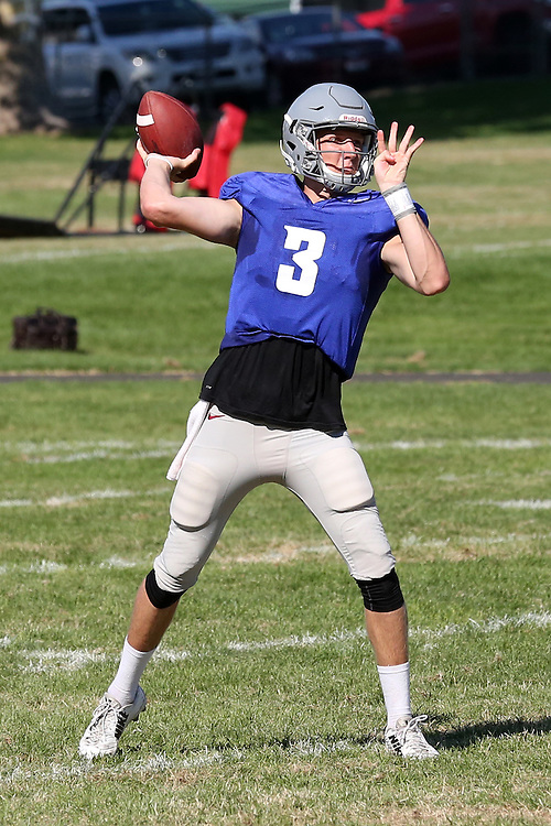 Tyler Hilinski shows great form while firing a pass during fall camp practice at Sacajawea Junior High School in Lewiston, Idaho, on August 12, 2016.