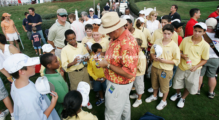 CROMWELL, CT 23 AUGUST 2005 082305BZ06-ESPN personality Chris Berman, center in flowered shirt, signs autographs <br /> after competing in the Buick Championship Long Drive Contest at the TPC at River Highllands Tuesday afternoon.<br /> Jamison C. Bazinet / Republican-American