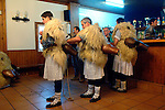 "A group of ""Joaldun"" get ready on January 30th, 2006 at the village of Ituren, Basque Country. Joaldun groups perform an ancient traditional carnival at the villages of Ituren and Zubieta, carrying sheep furs and big cowbells in their backs and making sound them in order to wake up the earth, to ask for a good new year, a good harvest and also to keep away the bad spirits. (Ander Gillenea / Bostok Photo)"