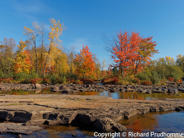 Fall colors along the Ouareau river in Saint-Liguori, Quebec