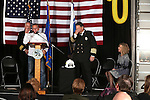 Retired engineer Dave Park speaks at Carson City Fire Chief Bob Schreihans' badge-pinning ceremony at Station 51 in Carson City, Nev., on Tuesday, Feb. 3, 2015. Nancy Schreihans is at right.<br /> Photo by Cathleen Allison