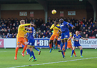 Aaron Pierre of Wycombe Wanderers and Adebayo Akinfenwa of AFC Wimbledon challenge for the ball during the Sky Bet League 2 match between AFC Wimbledon and Wycombe Wanderers at the Cherry Red Records Stadium, Kingston, England on 21 November 2015. Photo by Alan  Stanford/PRiME.