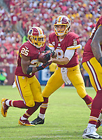 Washington Redskins quarterback Kirk Cousins (8) hands off to Washington Redskins running back Chris Thompson (25) in first quarter action against the Cleveland Browns at FedEx Field in Landover, Maryland on October 2, 2016.<br /> Credit: Ron Sachs / CNP /MediaPunch ***EDITORIAL USE ONLY***