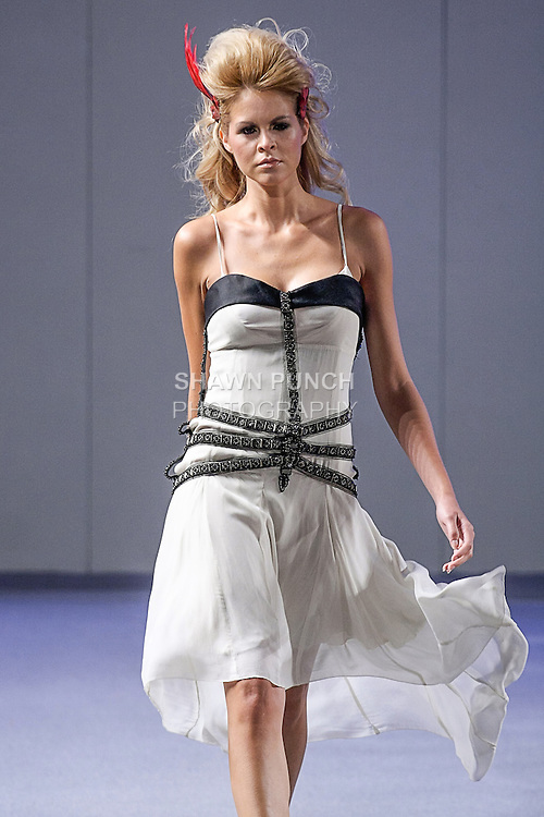 Model walks runway in an outfit from the Marisu Miranda Spring 2013 Valley of Gold collection, during Couture Fashion Week in New York City, September 15, 2012.