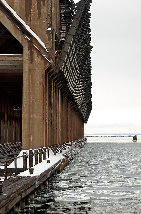 An abandoned iron ore loading dock on the shore of an icy Lake Superior. Marquette, MI