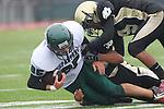 Torrance, CA 10/05/11 - unidentified South Torrance player(s) and Shane Scott (Peninsula #18) and Jordan Gates (Peninsula #9) in action during the Peninsula vs South Torrance Junior Varsity football game.
