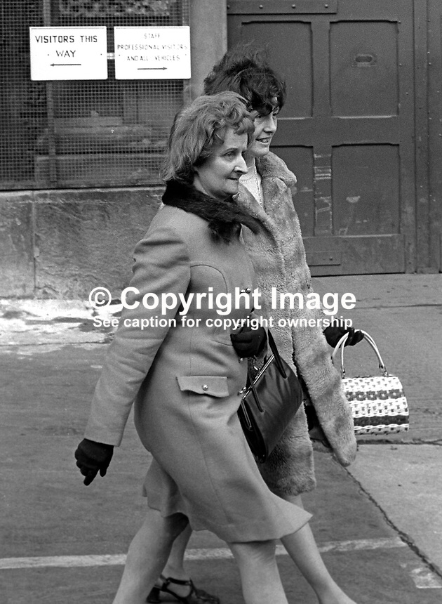 The wife, Betty Brown, and mother-in-law, Mrs Mary Mahood, of Albert Brown, leaving Crumlin Road jail, Belfast, 6th April 1973, after learning that Brown&rsquo;s death sentence for the murder of RUC constable, Gordon Harron, had been commuted to a prison term. In February 1973 when the fatal shooting occured the death sentence was mandatory for the murder of a police officier. April, 1973, 7304060189b<br />
