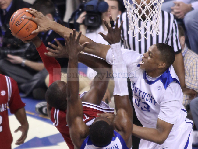 Freshman forward Daniel Orton blocks a Arkansas player during the first half of the game at Rupp Arena on Saturday. Photo by Zach Brake | Staff..