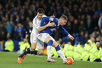 Jack Cork competes with Ross Barkley during the Barclays Premier League match between Everton and Swansea City played at Goodison Park, Liverpool