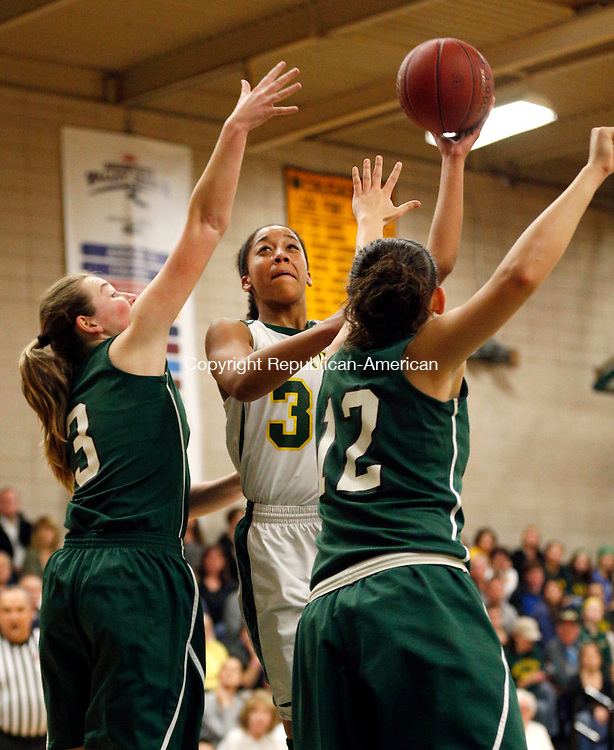 Waterbury, CT- 10 March 2015-031015CM11-  Holy Cross' Aiyana Ward shoots over Enfield's Hannah Lempitsky, left, and Olivia Caronna during their state tournament matchup in Waterbury on Tuesday.   Cross fell to Enfield, 45-38. Christopher Massa Republican-American