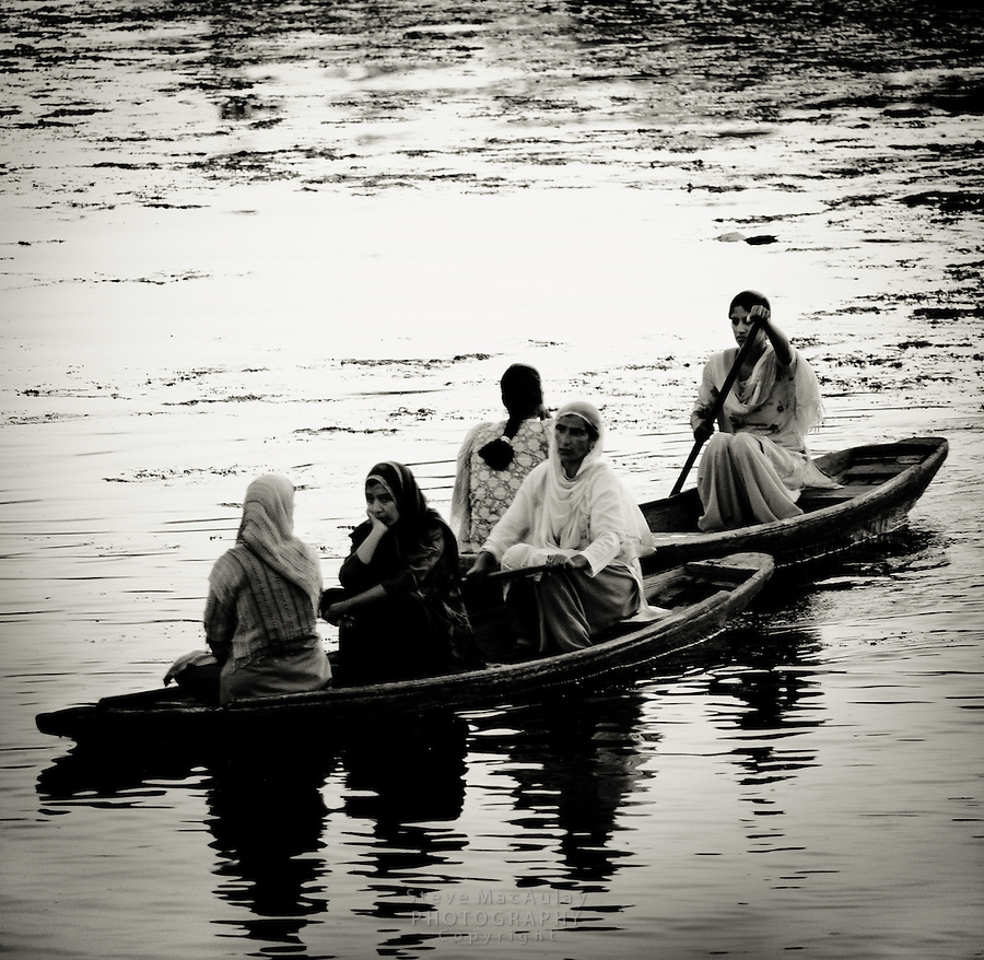 Muslim women on a Shikara, or gondola boat, on Dal Lake, Srinagar, Kashmir, India.