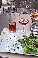 Mets Vins Restaurant. Salad cheese rose wine. Perpignan, Roussillon, France.
