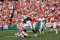 Oakland Raiders TE Randal Williams picks up seven yards on a pass play in the first quarter as he is tackled by Chiefs LB Keyaron Fox at Arrowhead Stadium in Kansas City, Missouri on November 19, 2006. Kansas City won 17-13.