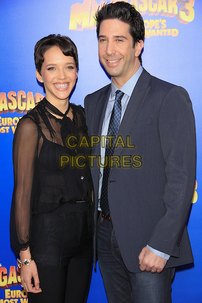 "Zoe Buckman & David Schwimmer.The New York Premiere of ""Madagascar 3: Europe's Most Wanted"" held at Ziegfeld Theater, New York, NY, USA..June 7th, 2012.half length suit blue tie black trousers sheer blouse married husband wife .CAP/LNC/TOM.©LNC/Capital Pictures."