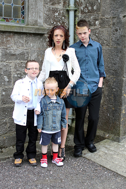 Josh Duffy with his family at the 2011 Donore NS First Holy Communion...(Photo credit should read Jenny Matthews www.newsfile.ie)....This Picture has been sent you under the conditions enclosed by:.Newsfile Ltd..The Studio,.Millmount Abbey,.Drogheda,.Co Meath..Ireland..Tel: +353(0)41-9871240.Fax: +353(0)41-9871260.GSM: +353(0)86-2500958.email: pictures@newsfile.ie.www.newsfile.ie.