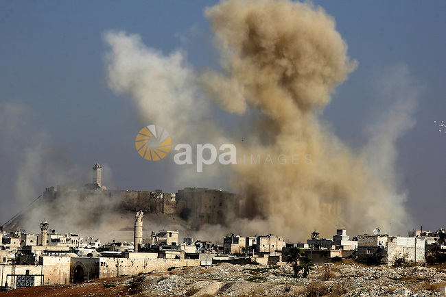 Smoke billows following a reported airstrike by government forces next to the Aleppo Citadel in the northern Syrian city on November 7, 2015. More than 250,000 people have died in Syria's conflict, which several rounds of diplomatic pushes have failed to end. Photo by Ameer al-Halbi