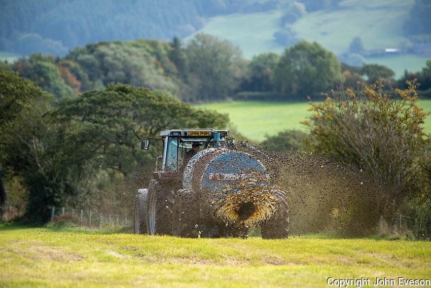 Spreading slurry on silage aftermath, near Preston, Lancashire.