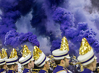 Purple smoke fills the air prior to the Huskies' arrival.