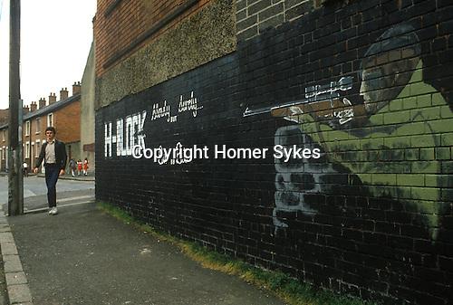 Belfast Northern Ireland.  1980s Mural depicts an IRA gunman.