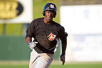Odubel Herrera #2 of the Hickory Crawdads hustles towards third base against the Kannapolis Intimidators at Fieldcrest Cannon Stadium on April 17, 2011 in Kannapolis, North Carolina.   Photo by Brian Westerholt / Four Seam Images