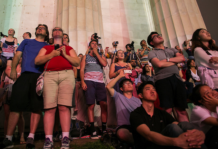 UNITED STATES - JULY 4 - Tourists and spectators watch fireworks as they explode over the National Mall for Fourth of July celebrations in Washington, photographed from Lincoln Memorial on Saturday, July 4, 2015. (Photo By Al Drago/CQ Roll Call)