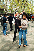 Chinese Dancers at Fuxing Park, in the former French Concession of Shanghai. Early morning, the park fills with dancers and  people exercising and practicing  tai chi. Not at all shy to strut their stuff, locals think of it as a chance to socialize, have fun and get some exercise.